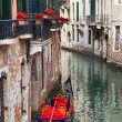 Backstreet canal Venice with empty gondola — Stock Photo #34603783