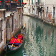 Backstreet canal Venice with empty gondola — Stock Photo #34603965
