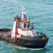 Stock Photo: Tug boat alone cruising but not towing