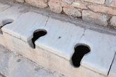 Communal Roman toilets Ephesus Turkey — Stock Photo