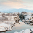 Thingvellir National Park Iceland snow covered mountains and rocky terrain — Stock Photo #36441435