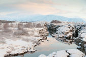 Thingvellir National Park Iceland snow covered mountains and rocky terrain — Foto de Stock