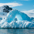 Stock Photo: Arch shaped iceberg Antarctica