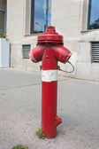 Fire hydrant with two hoze outlest on an urban street — Stock Photo