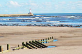 Spittal beach and pier with lighthouse — Stock Photo