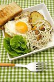 Salad of baby eels with garlic — Stock Photo