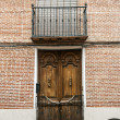 Brick facade with an old door — Stock Photo