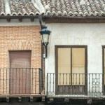 Brick facade with four windows — Stock Photo #24994851