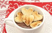 Cup with chocolate and bread hearts — Stock Photo