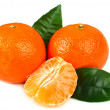 Ripe tangerines with cloves — Stockfoto
