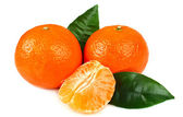 Ripe tangerines with cloves — Stock Photo