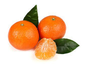 Ripe tasty tangerines with leaves — Stock Photo