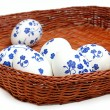 Easter egg with a pattern in a wicker basket — Stock Photo #23146298