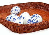 Easter egg with a pattern in a wicker basket — Stock Photo