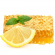 Stock Photo: Honey in honeycombs with lemon and mint.