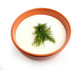 Isolated sour cream with a sprig of dill in a bowl. — Stock Photo