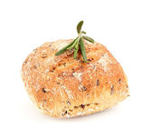 Whole wheat bun with seeds and a sprig of rosemary. — Stock Photo
