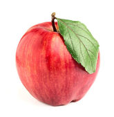 Striped red and yellow apple with leaf. — Stock Photo