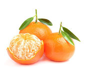 Tangerines with twigs and peeled. — Stock Photo