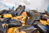 A paella pot with shell fish and rice — Stock Photo