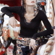 Beautiful girl on carousel amusement ride at the park. Fashion p — Stock Photo