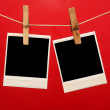 Old photos hanging on the clothesline isolated on red — Stok fotoğraf