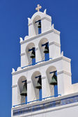 White bell tower of a church St. Irene of Oia, Santorini, Greece. — Stock Photo