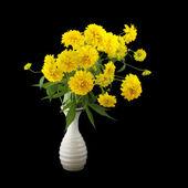 Rudbeckia flowers in vase iosolated on black — Stock Photo