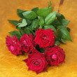 Bouquet of dark red roses on wood — Stock Photo
