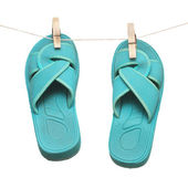 Green flipflops hanging on clotespin isolated on white — Stock Photo