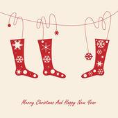 Christmas card with socks and snowflake — Stock Vector