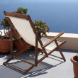 Stock Photo: Lounger on the beach villas in Santorini, Greece