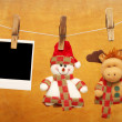 Photos and Christmas toys hanging on clothespins — Stock Photo