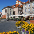 Stock Photo: Old houses with flowers in old town of Warsaw on sunny day