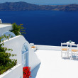 Open air cafe with beautiful view in Santorini, Greece — Stock Photo