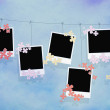 Photo blanks and flowers on a rope isolated — Stock Photo
