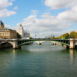 Palais de Justice and a bridge over the Seine river. Paris, Fran — Stock Photo #44221127