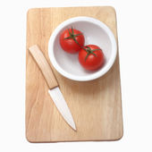 tomatoes and knife on the wood background  — Foto de Stock