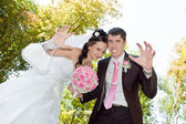 The groom and the bride are kidding — Stock Photo
