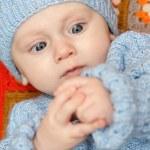 Baby boy explores his hands — Stock Photo