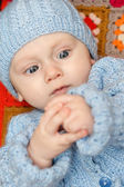 Baby boy explores his hands — Foto Stock