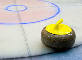 Curling stone on the Ice — Stock Photo