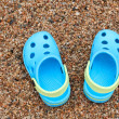 Stock Photo: Blue sandals slippers on sand