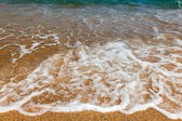 Waves on a sandy beach — Stock Photo