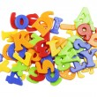 Plastic alphabet letters stacked on a white background — Stock Photo