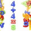 Plastic figures near plastic alphabet letters — Stock Photo