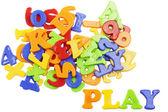 PLAY lettering near plastic alphabet letters — Stock Photo
