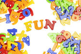 Fun lettering near plastic alphabet letters — Stock Photo