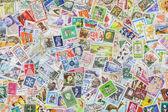Postage stamps from different countries and times — Stock Photo