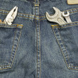 Working tools in jeans pockets — Stock Photo